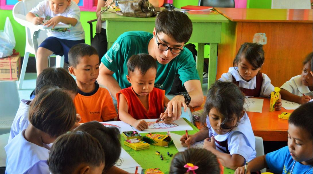 Volunteer works with children during the festive season in the Philippines